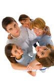 Group of teenagers in huddle. On white background Royalty Free Stock Photos