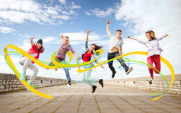 Group of teenagers jumping. Summer, sport, dancing and teenage lifestyle concept - group of teenagers jumping Royalty Free Stock Photo