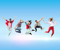 Group of teenagers jumping Stock Images