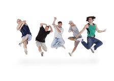Group of teenagers jumping over white Stock Image