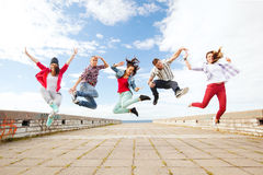 Group of teenagers jumping stock photo