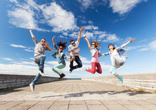 Group of teenagers jumping. Summer, sport, dancing and teenage lifestyle concept - group of teenagers jumping