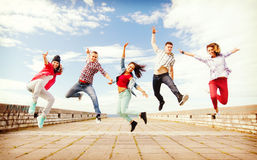 Group of teenagers jumping Royalty Free Stock Photography