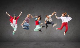 Group of teenagers jumping Stock Photos