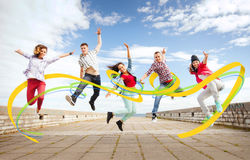 Group of teenagers jumping Royalty Free Stock Images