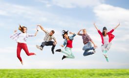 Group of teenagers jumping Stock Photography