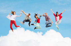 Group of teenagers jumping. Summer, sport, dancing and teenage lifestyle concept - group of teenagers jumping Royalty Free Stock Photos