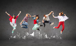 Group of teenagers jumping Royalty Free Stock Image