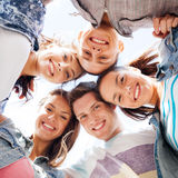 Group of teenagers looking down Royalty Free Stock Photos