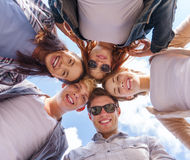 Group of teenagers looking down Stock Photos