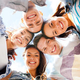 Group of teenagers looking down Royalty Free Stock Image