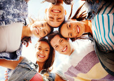 Group of teenagers looking down Stock Photo