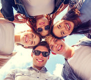 Group of teenagers looking down Royalty Free Stock Images