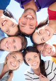 Group of teenagers looking down Royalty Free Stock Photography