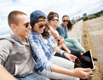 Group of teenagers looking at tablet pc Royalty Free Stock Photos