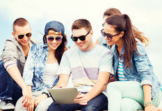 Group of teenagers looking at tablet pc Stock Image