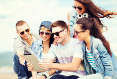 Group of teenagers looking at tablet pc Stock Photography