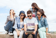 Group of teenagers looking at tablet pc Royalty Free Stock Image