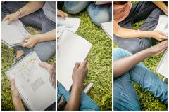 Group of teenagers making school tasks seated on the grass. Scho. Ol and friendship concept. Notebooks detail Stock Photos