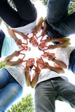 Group of teenagers. Mixed group of teenagers standing in a circle Stock Image