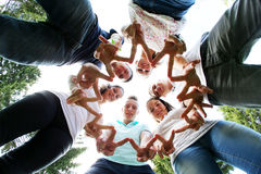 Group of teenagers. Mixed group of teenagers standing in a circle Royalty Free Stock Images