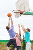 Group of teenagers playing basketball Royalty Free Stock Image