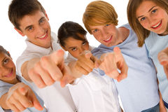 Group of teenagers pointing. On white background Stock Photography