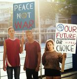 Group of teenagers protesting demonstration holding posters antiwar justice peace concept Royalty Free Stock Image