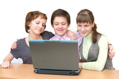 Group of teenagers - pupils having fun on laptop. Group of young students - pupils having fun on laptop Royalty Free Stock Images