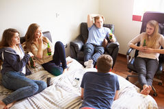 Group Of Teenagers Relaxing In Bedroom stock images
