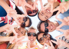 Group of teenagers showing finger five gesture Royalty Free Stock Photo