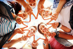 Group of teenagers showing finger five. Summer holidays and teenage concept - group of teenagers showing finger five gesture Stock Photo
