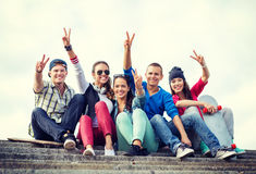 Group of teenagers showing finger five Stock Photo