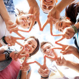 Group of teenagers showing finger five Royalty Free Stock Image