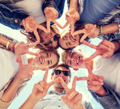 Group of teenagers showing finger five Royalty Free Stock Photos