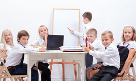 The group of teenagers sitting in a business stock photo