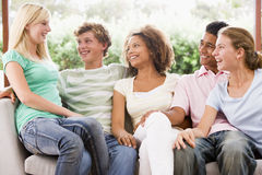 Group Of Teenagers Sitting On A Couch Royalty Free Stock Images