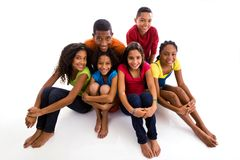 Group of teenagers sitting Stock Photos