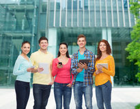 Group of teenagers with smartphones and tablet pc Royalty Free Stock Image