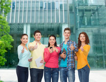 Group of teenagers with smartphones and tablet pc Royalty Free Stock Photos