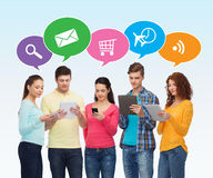 Group of teenagers with smartphones and tablet pc. People, communication and technology concept - smiling friends with smartphones and tablet pc computers over Stock Images