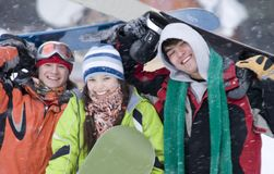 Group of teenagers snowborders. Group of sports teenagers snowborders in mountains in snow Stock Photos