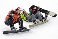 Group of teenagers snowborders. Group of sports teenagers snowborders in mountains in snow Stock Photo