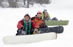 Group of teenagers snowborders. Group of sports teenagers snowborders in mountains in snow Royalty Free Stock Photos