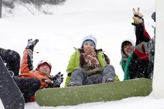 Group of teenagers snowborders. Group of sports teenagers snowborders in mountains in snow Stock Images