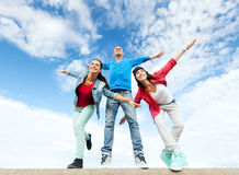 Group of teenagers spreading hands. Sport, dancing and urban culture concept - group of teenagers spreading hands Stock Image