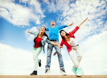 Group of teenagers spreading hands. Sport, dancing and urban culture concept - group of teenagers spreading hands Royalty Free Stock Images