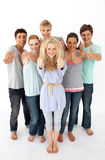 Group of teenagers standing in front of the camera Royalty Free Stock Images
