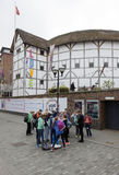 Group of teenagers stands in front of shakespeare`s globe theatr. London, United Kingdom, 6 may 2017: group of teenagers stands in front of shakespeare`s globe Stock Photo