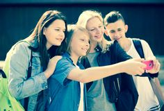 Teenagers taking pictures of themselves on smartphone. Group of teenagers taking pictures of themselves on smartphone Royalty Free Stock Photography